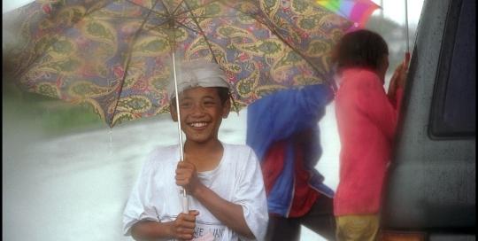 Boy Holding Umbrella